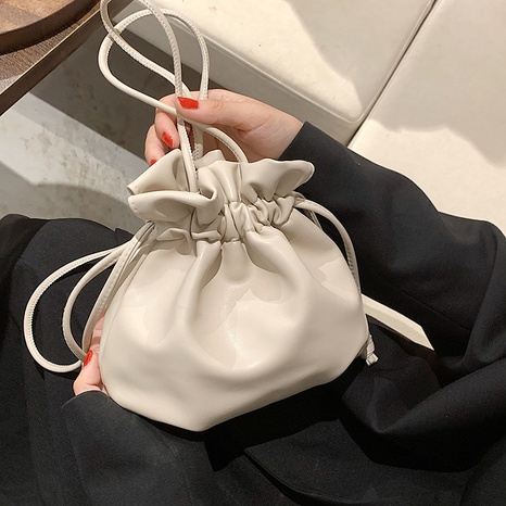 wholesale solid color fold drawstring messenger bucket bag nihaojewelry  NHLH390451's discount tags