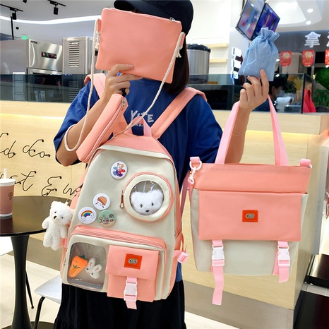 wholesale cartoon doll pendant badge backpack four-piece set nihaojewelry  NHGA390517's discount tags