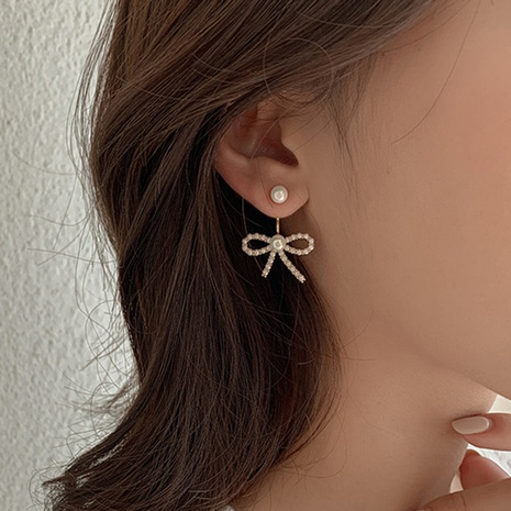 wholesale fashion pearl metal bow earrings Nihaojewelry  NHGY391584's discount tags