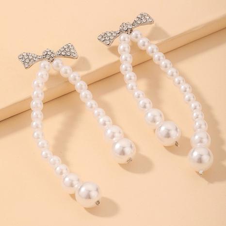 Großhandel Schmuck Perle eingelegte Strass Bogen Ohrringe Nihaojewelry NHNJ390660's discount tags