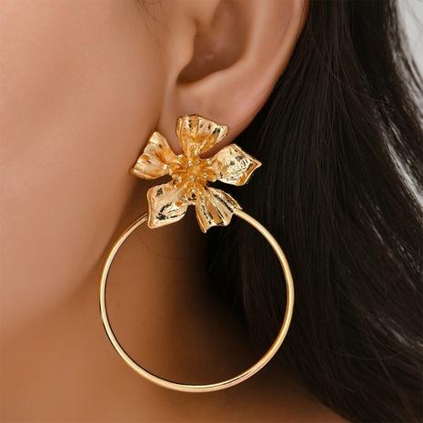 Großhandel Schmuck Retro Metall dreidimensionale Blumenohrringe Nihaojewelry NHYAO390678's discount tags