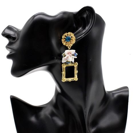 Großhandel Schmuck Metall geometrische Rahmen Blumenohrringe Nihaojewelry NHNT391077's discount tags