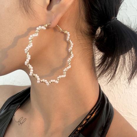 Großhandel Schmucklegierung Perle Twist Kreis Ohrringe Nihaojewelry NHMD391381's discount tags
