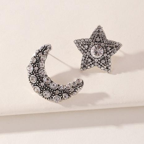 Großhandel Schmuck einfache fünfzackige Sternmond asymmetrische Ohrringe Nihaojewelry NHNZ391382's discount tags