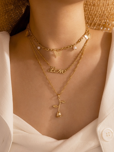 wholesale Korean new pearl metal rose pendant three-layer necklace Nihaojewelry  NHGY391505's discount tags