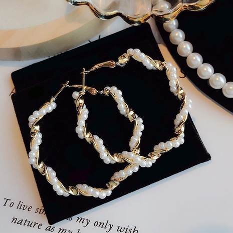 twisted pearl beaded C-shaped fashion earrings wholesale jewelry Nihaojewelry NHHER391713's discount tags