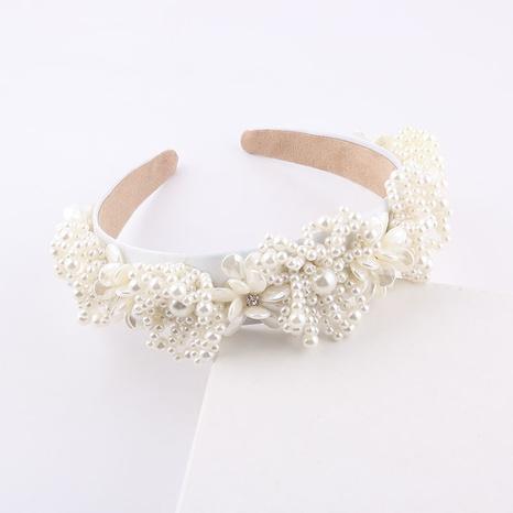 wholesale new fashion inlaid pearl flower wide headband Nihaojewelry  NHWJ392118's discount tags