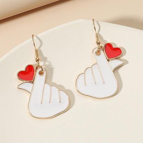 heart gesture metal dripping oil cute earrings wholesale jewelry Nihaojewelry NHDP392170's discount tags