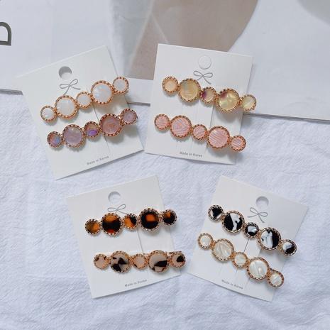 Wholesale Korean acetic acid circle word clip girl side clip clip headdress NHQIY392188's discount tags