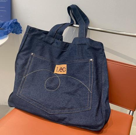 vente en gros nouvelle tendance sac à bandoulière en jean coréen Nihaojewelry NHTG392600's discount tags