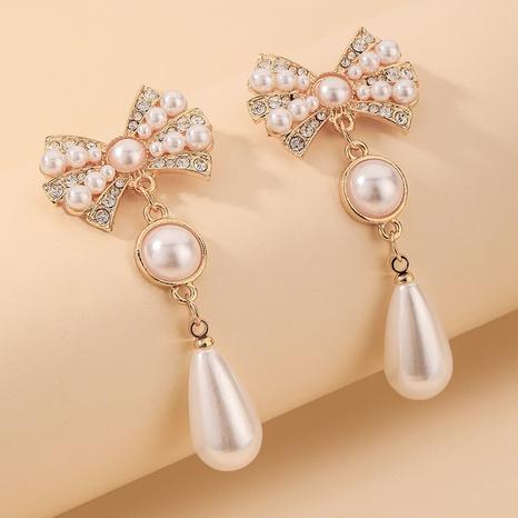 Wholesale Jewelry Retro Rhinestone Bowknot Water Drop Pearl Earrings Nihaojewelry NHNJ393036's discount tags