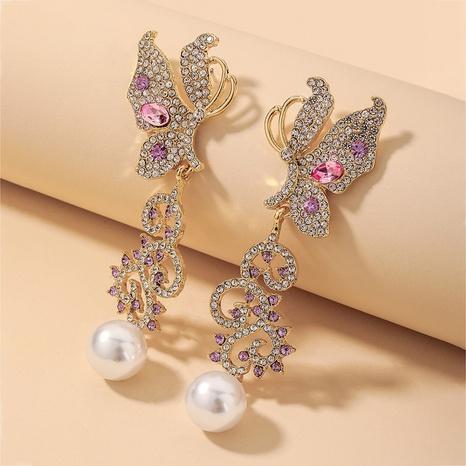 wholesale pendientes de perlas de mariposa hueca de diamantes de imitación retro Nihaojewelry NHNJ393041's discount tags