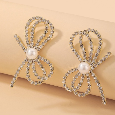 wholesale fashion inlaid rhinestone pearl bow earrings Nihaojewelry NHNJ393612's discount tags