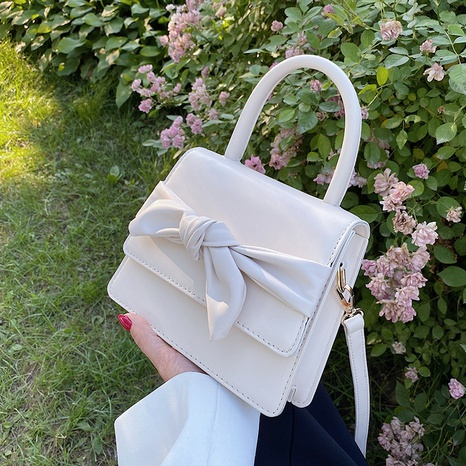 wholesale solid color bow messenger square bag Nihaojewelry NHAV378020's discount tags