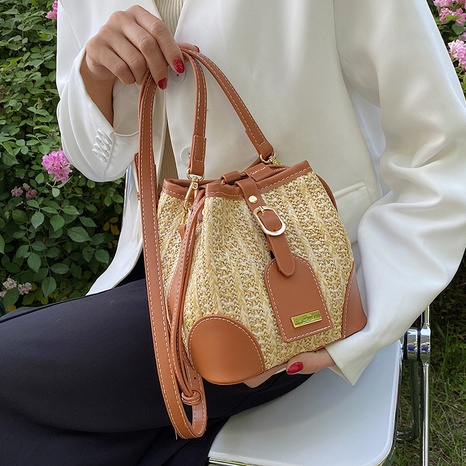 Nihaojewelry wholesale new trendy contrast color messenger straw bucket bag NHAV378224's discount tags