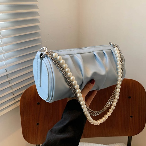 wholesale solid color pearl chain cylinder shoulder arm bag Nihaojewelry NHGN394834's discount tags