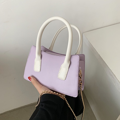 wholesale clashing color metal chain messenger bag Nihaojewelry NHGN394835's discount tags