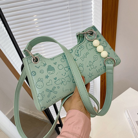 wholesale cartoon pattern embrossed messenger shoulder bag nihaojewelry  NHGN395005's discount tags