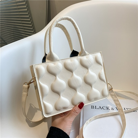 wholesale heart embrossed messenger portable small square bag nihaojewelry   NHRU395022's discount tags