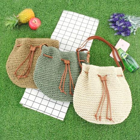 straw woven tassel drawstring bucket bag wholesale Nihaojewelry NHXM394741's discount tags