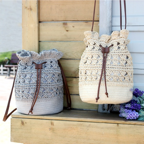 fashion crochet flower straw woven bucket bag wholesale Nihaojewelry NHXM394746's discount tags