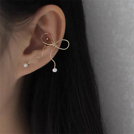 wholesale jewelry Korean simple bowknot pearl ear clips nihaojewelry NHMS378439's discount tags
