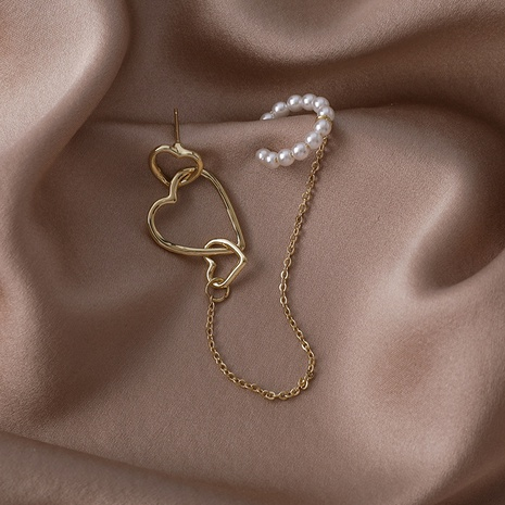 nihaojewelry moda corazón hueco cadena de perlas borla pendientes de una pieza joyería al por mayor NHMS378453's discount tags
