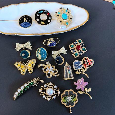 nihaojewelry fashion drip glaze gemstone pearl stone flora blue planet brooch wholesale jewelry NHOM378510's discount tags