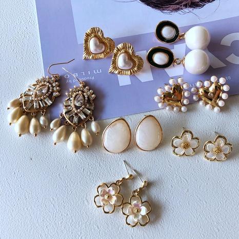 nihaojewelry simple flor corazón resina perla joya pendientes joyería al por mayor NHOM378513's discount tags