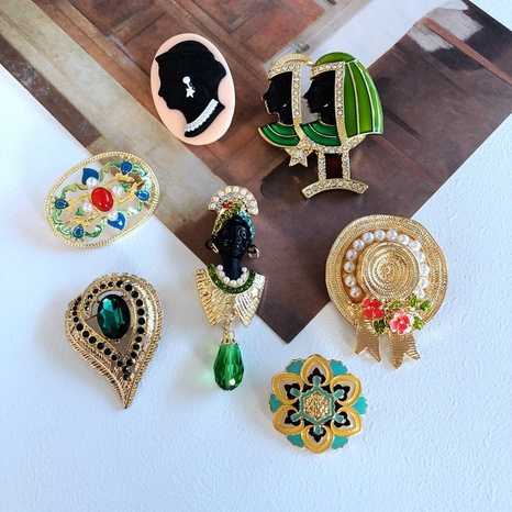 Nihaojewelry Retro Pearl Flowers Dripping Glaze Jewel Straw Hat Brooch Wholesale Jewelry NHOM378519's discount tags