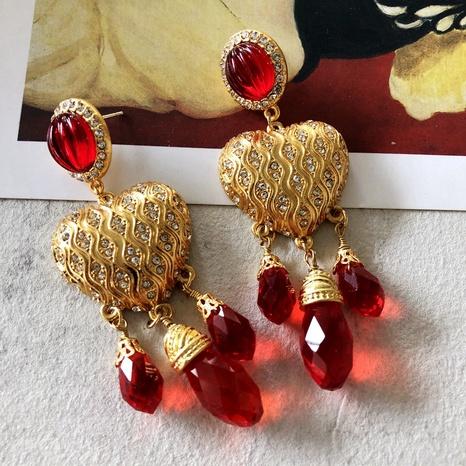 Nihaojewelry joyas al por mayor galvanoplastia pendientes de borla de corazón con incrustaciones de oro real NHOM378527's discount tags