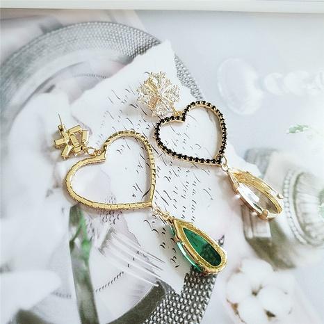 Nihaojewelry joyas al por mayor pendientes asimétricos de cristal de gota de agua de diamante de corazón hueco NHVA378581's discount tags