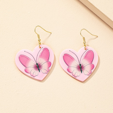 Al por mayor joyería retro en forma de corazón pendientes con patrón de mariposa nihaojewelry NHAI379028's discount tags