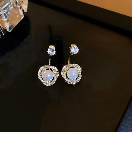 Nihaojewelry joyas al por mayor pendientes geométricos simples de perlas de diamantes de imitación al por mayor NHOT378766's discount tags