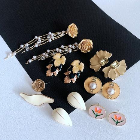 Nihaojewelry Jewelry Wholesale Vintage Pearl Enamel Tassel Earrings  NHOM379296's discount tags