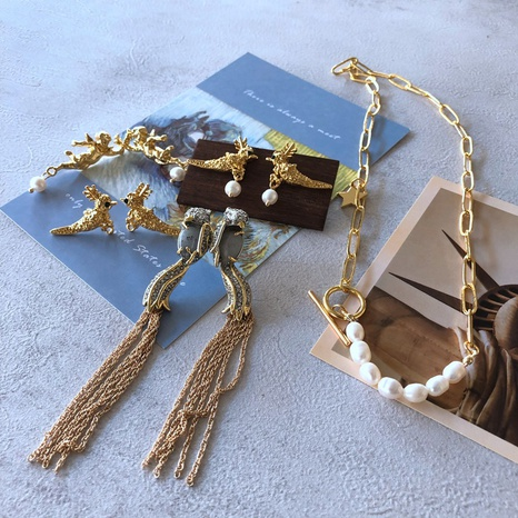 Nihaojewelry Jewelry Wholesale Pearl Stone Bead Bird Angel Tassel Earring Necklace  NHOM379299's discount tags