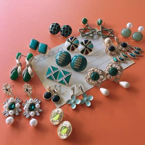 Nihaojewelry jewelry wholesale geometric drip-glazed pearl glass gemstone earrings  NHOM379302's discount tags