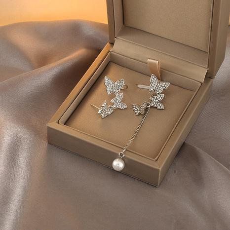 Nihaojewelry jewelry wholesale new asymmetric butterfly long pearl tassel earrings NHPA379637's discount tags