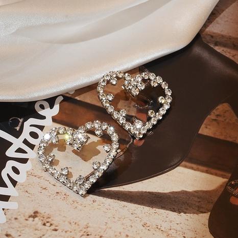 nihaojewelry moda con incrustaciones de diamantes huecos pendientes de cobre en forma de corazón joyería al por mayor NHHT379704's discount tags