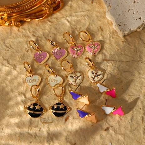 Pendientes colgantes de planeta en forma de corazón de moda de nihaojewelry, joyería al por mayor NHJIE379726's discount tags