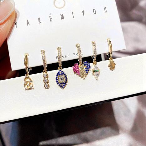 wholesale joyería de moda ojos del diablo pendientes de circón con incrustaciones de cobre en forma de corazón conjunto nihaojewelry NHCG379734's discount tags