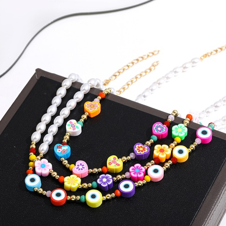 Nihaojewelry Pearl Multicolor Flower Eye Pendant Necklace Wholesale Jewelry NHLL379946's discount tags