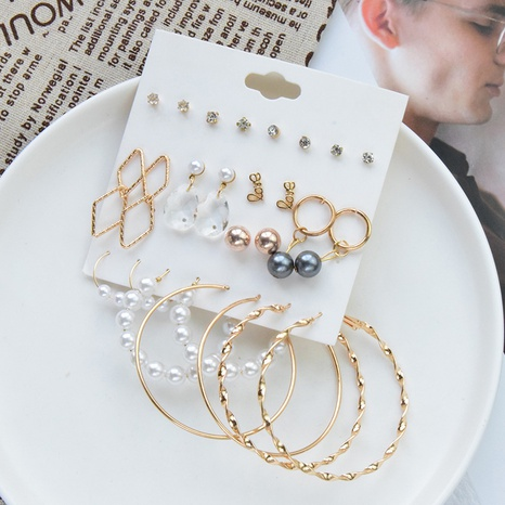 Nihaojewelry jewelry wholesale new simple circle pearl pendant earrings combination set NHSD379954's discount tags