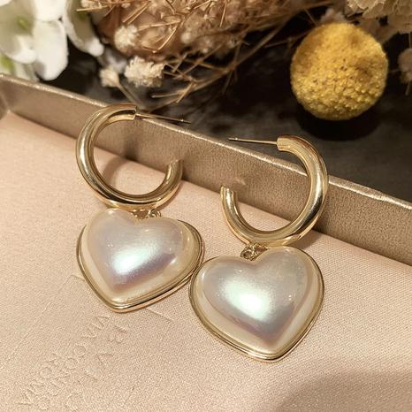 nihaojewelry retro barroco pendientes de perlas blancas en forma de corazón joyería al por mayor NHWK379976's discount tags