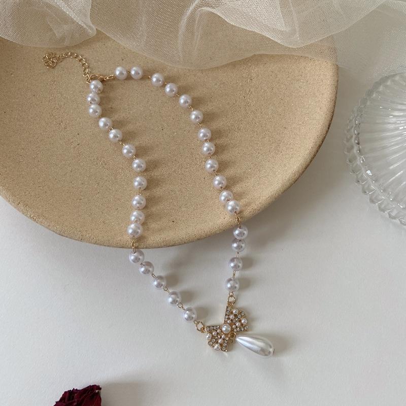 wholesale fashion bowknot diamondstudded water drop pearl necklace nihaojewelry NHPF381106
