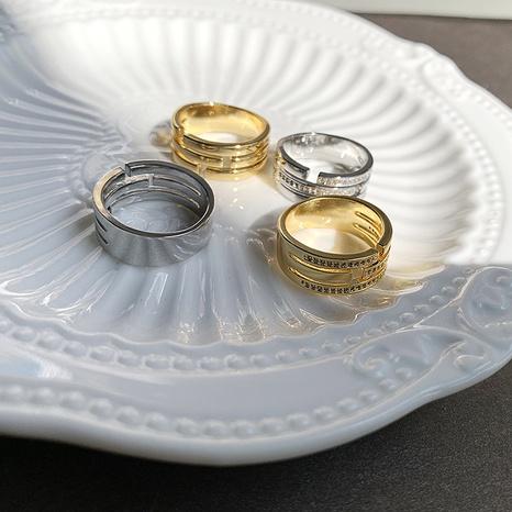 Al por mayor joyería hueca anillo de cobre de 3 capas Nihaojewelry NHGI381273's discount tags