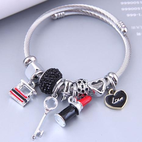 Nihaojewelry wholesale jewelry simple heart lock lipstick multi-element pendant bracelet NHSC383175's discount tags