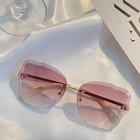 retro metal frameless wave pattern flower sunglasses wholesale nihaojewelry NHXU403253's discount tags
