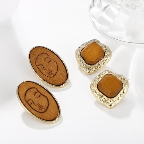 Großhandel Schmuck ethnischen Stil Holz Gesicht Linienmuster runden Anhänger Ohrringe nihaojewelry NHAYN406345's discount tags