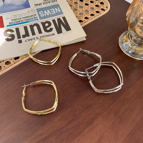 Großhandel Schmuck doppellagige hohle Creolen nihaojewelry NHMS406572's discount tags